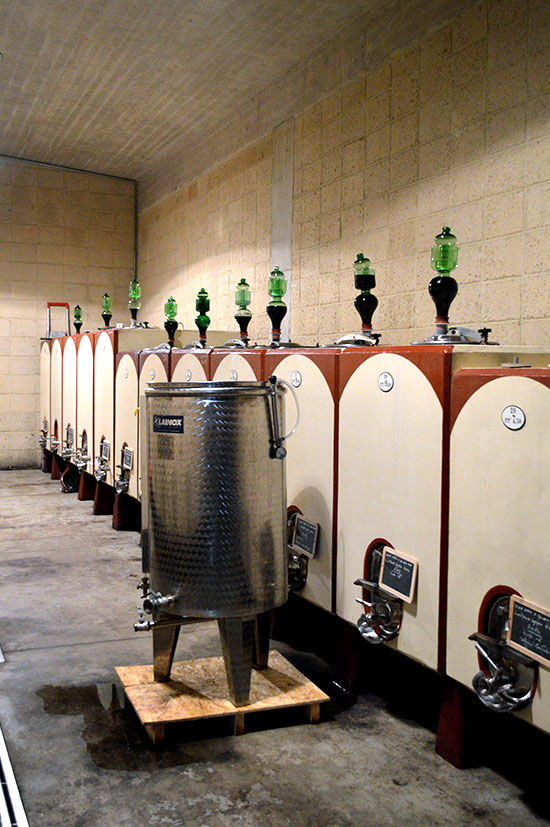 The wine fermenting in concrete vats