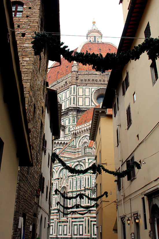 Florence Cathedral visible through the Christmas decorations.